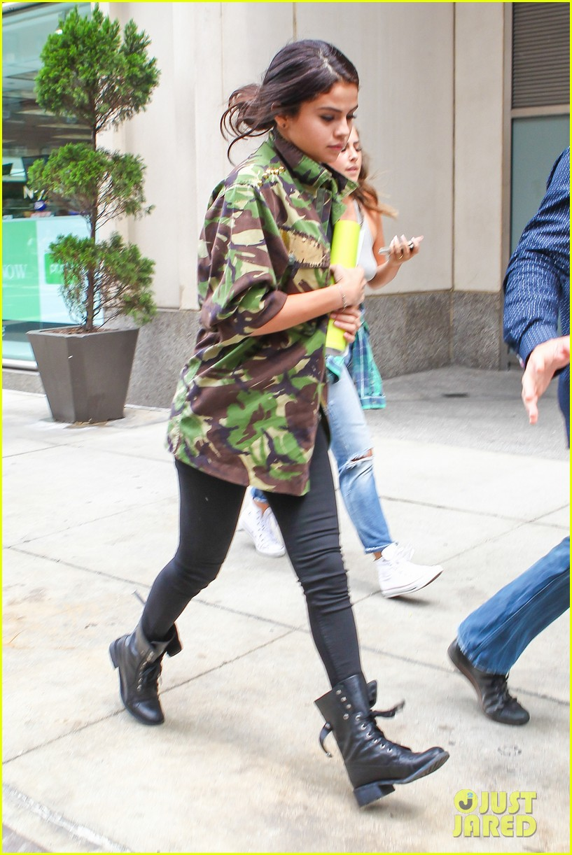 selena gomez covers up camo jacket 04