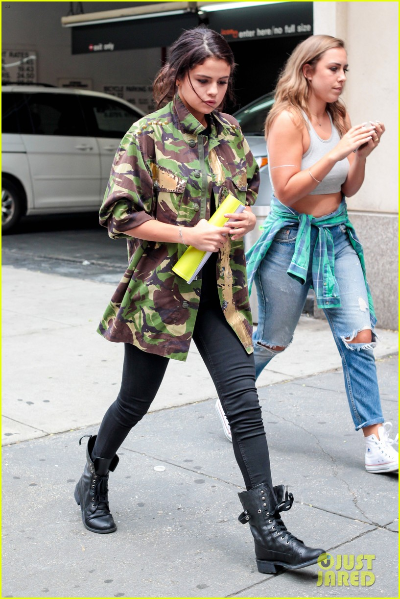 selena gomez covers up camo jacket 063153055
