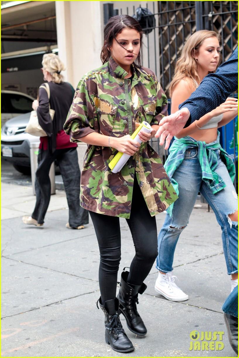 selena gomez covers up camo jacket 07