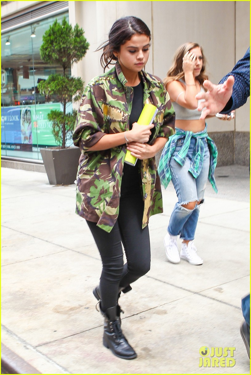 selena gomez covers up camo jacket 143153063