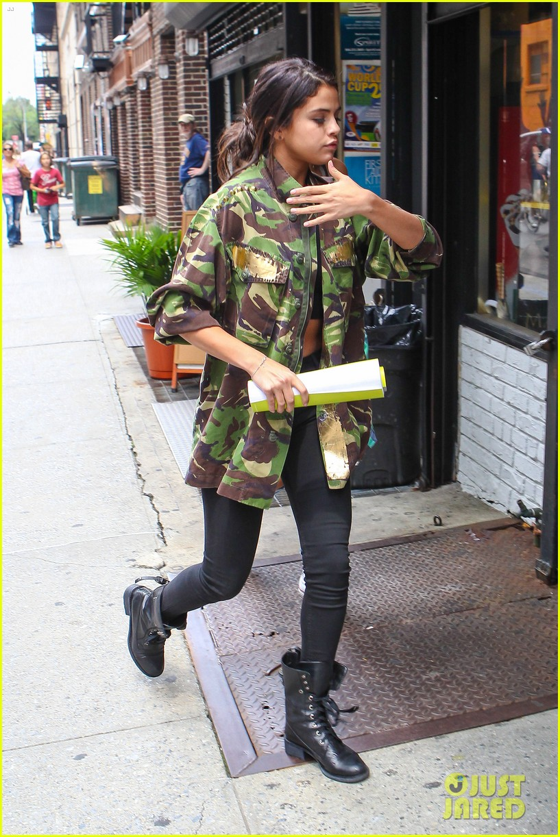 selena gomez covers up camo jacket 17