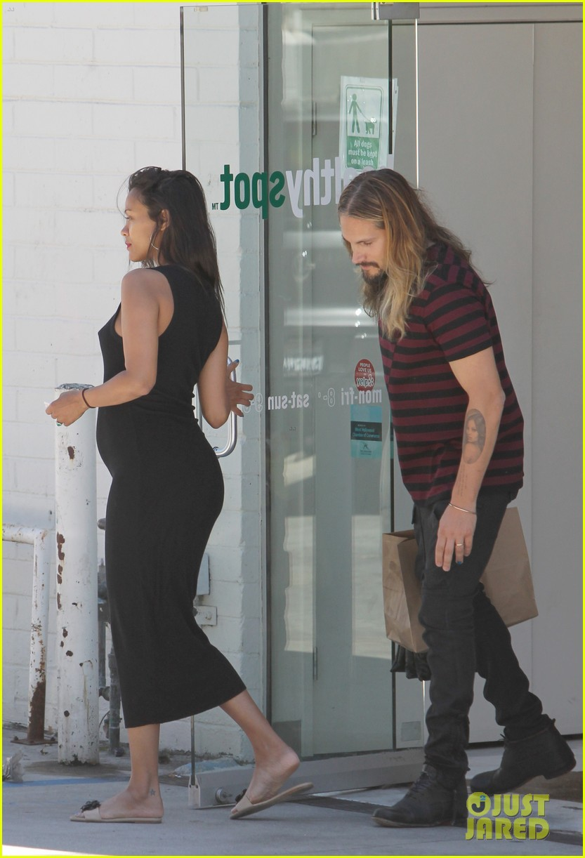 zoe saldana marco perego cannot keep their hands off each other 143178437
