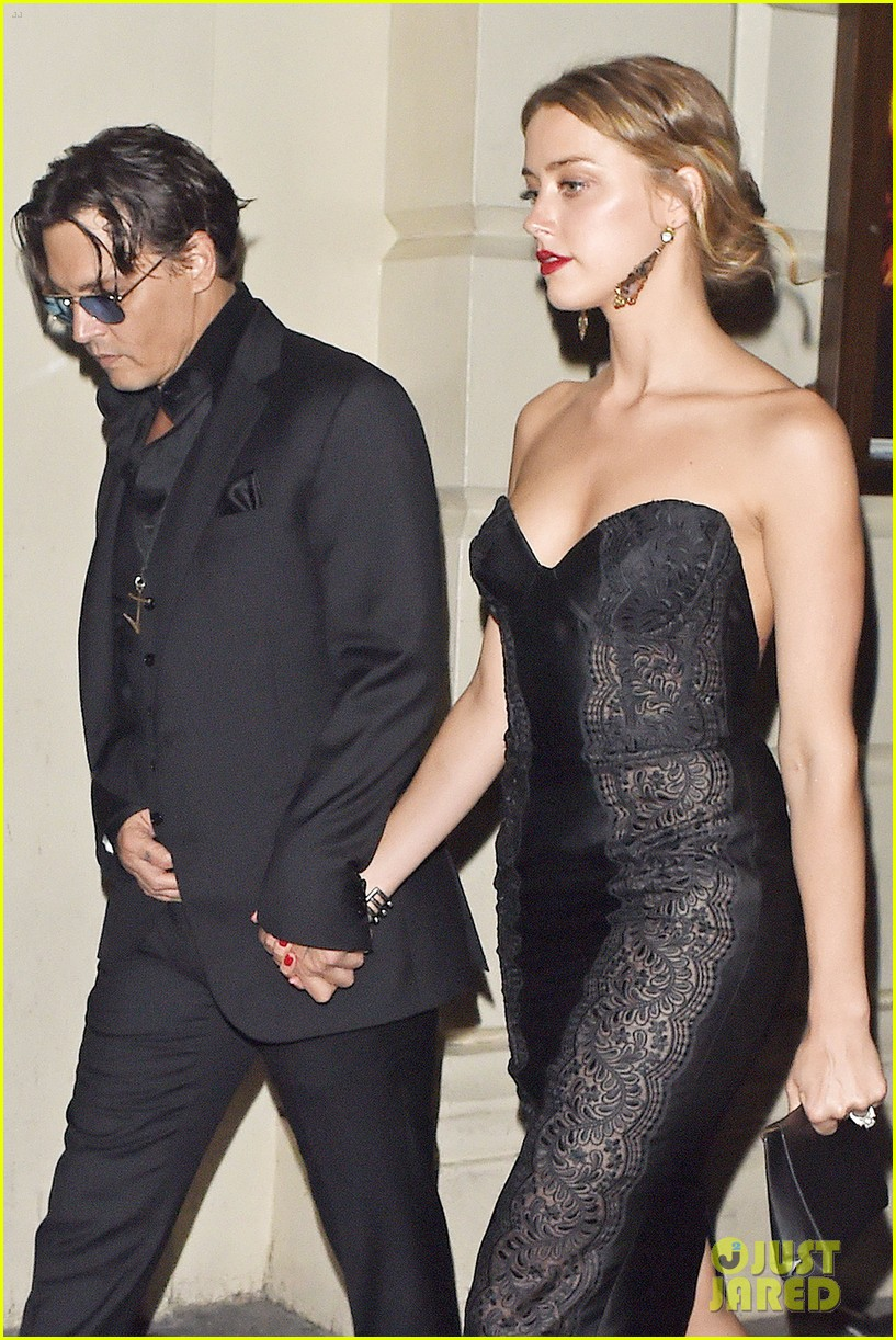 johnny depp amber heard hold hands gq men of the year awards 10