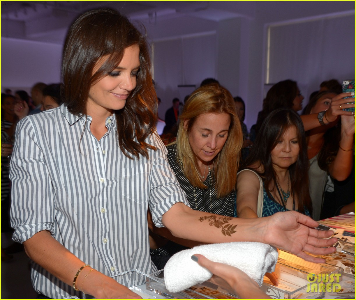 katie holmes gets temporary tattoos at joe zee nyfw event 19