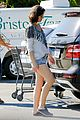 milla jovovich keeps her baby bump covered with baggy shirt 01