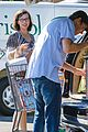 milla jovovich keeps her baby bump covered with baggy shirt 05