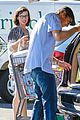 milla jovovich keeps her baby bump covered with baggy shirt 11