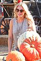 leann rimes lifts a huge pumpkin 11
