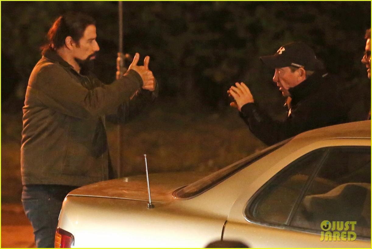 Full sized photo of john travolta puts life on the line as repairmen