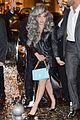 lady gaga brings attention to big grey wig in milan 07