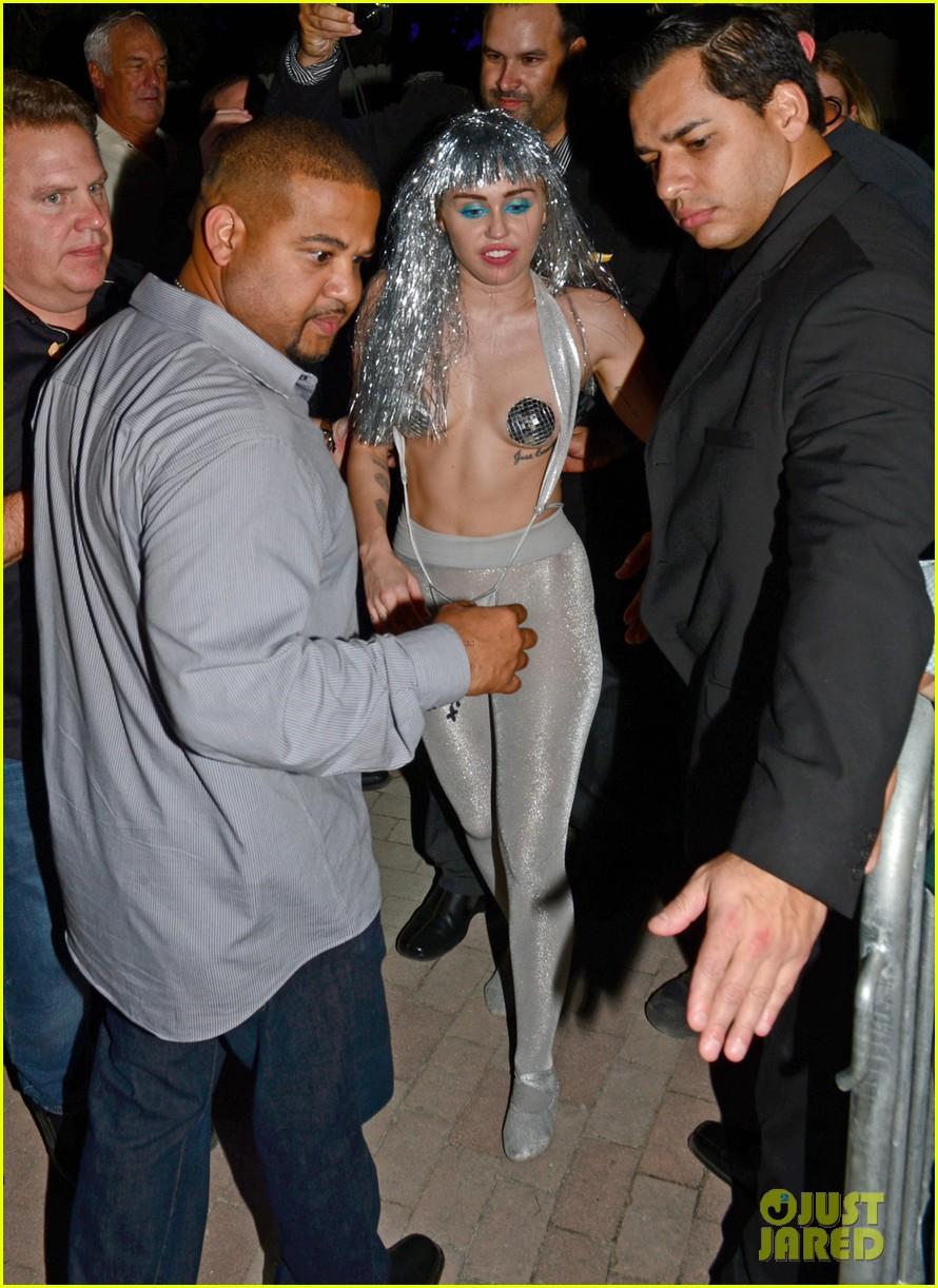 miley cyrus wears nipple pasties silver wig for art basel 02