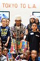 pharrell williams helps uniqlo host charity shopping event 07