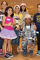 pharrell williams helps uniqlo host charity shopping event 11