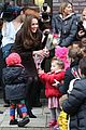 kate middleton steps out with growing baby bump to visit the fostering 09