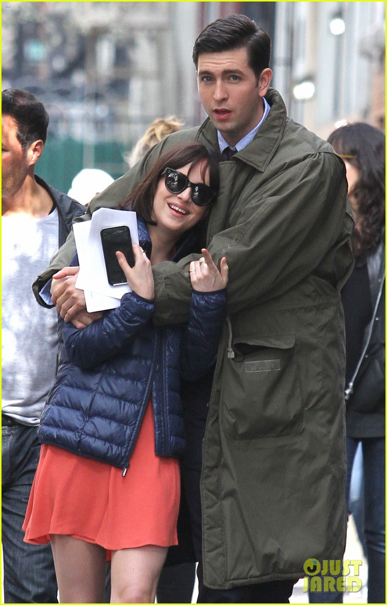 dakota johnson cuddles up to nicholas braun 123354220