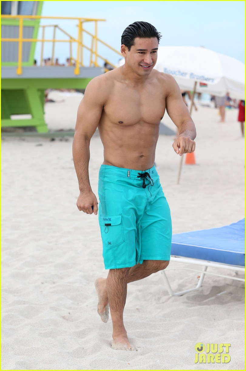 mario lopez gets shirtless at the beach 01