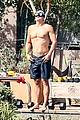 orlando bloom goes shirtless for outdoor swim weights workout 18