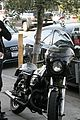 olivier martinez rides motorcycle with baguette down his jacket 17