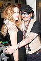 johnny depp helps stella mccartney present at la fashion show 03