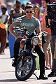 zac efron films baywatch on motorcycle 30