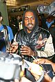 kanye west breaks up paparazzi fight at lax 02