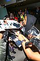 kanye west breaks up paparazzi fight at lax 26