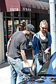 behati prinsloo shows off tiny baby bump with adam levine 02