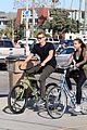joel kinnaman goes for bike ride with cleo wattenstrom 02