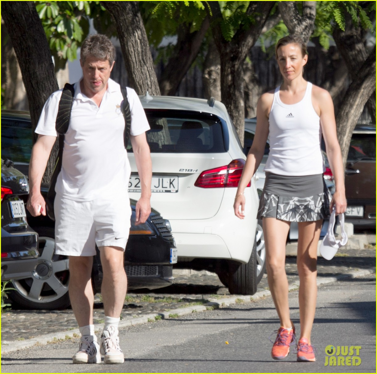 Hugh Grant Hits Tennis...