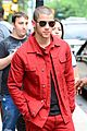 nick jonas red suit aol build appearance 04