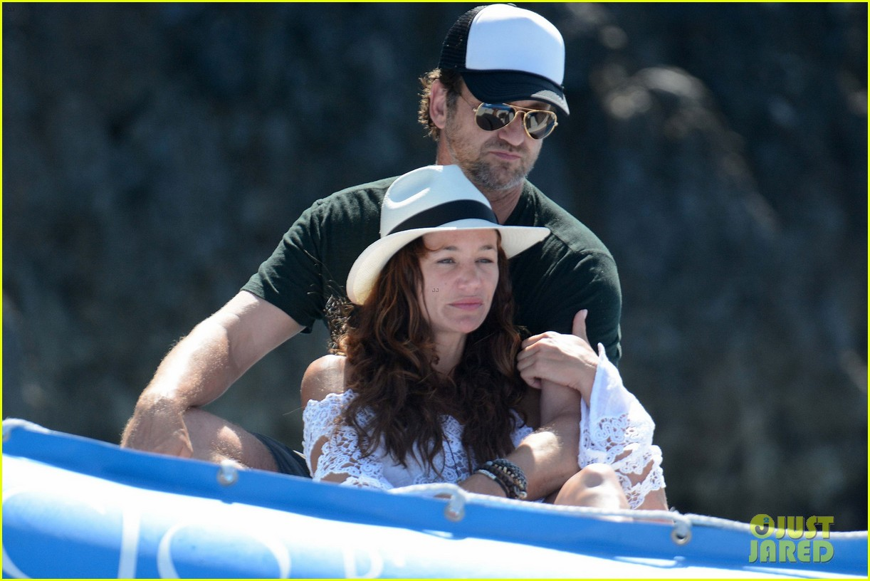gerard butler girlfriend morgan brown romantic boat ride in italy 023706578