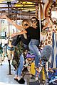 kourtney khloe kardashian ride a merry go round together 01