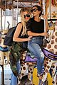 kourtney khloe kardashian ride a merry go round together 18