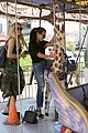 kourtney khloe kardashian ride a merry go round together 27