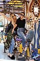 kourtney khloe kardashian ride a merry go round together 29