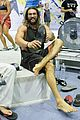 jason momoa biceps are bulging all over on the climbing wall 01