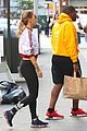 rita ora gets distracted by an adorable pup on her way to work 02