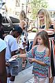 busy philipps hosts baby2baby back to school event with daughter birdie 14