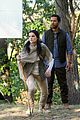 jaimie alexander crawls around the woods while filming for blindspot 09