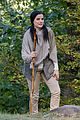 jaimie alexander crawls around the woods while filming for blindspot 21