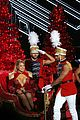 mariah carey holds bryan tanaka hand on stage at christmas concert 06