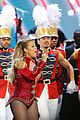 mariah carey holds bryan tanaka hand on stage at christmas concert 22