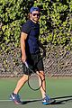 bradley cooper works on his serve on the tennis court 05