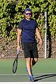 bradley cooper works on his serve on the tennis court 08