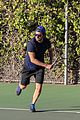 bradley cooper works on his serve on the tennis court 10