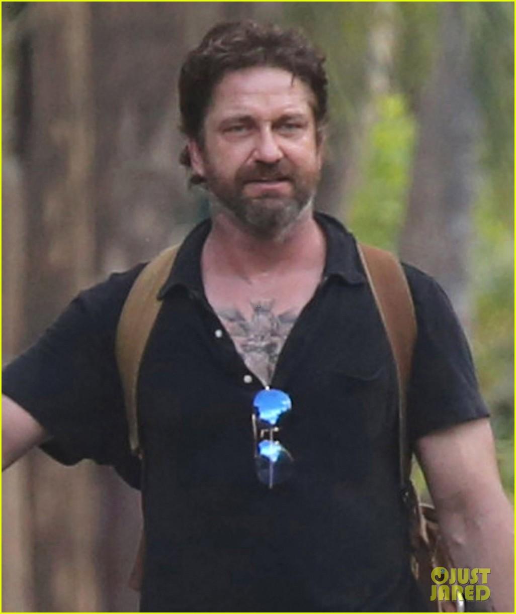 gerard butler puts tattoos on display in cancun with morgan brown 103863433