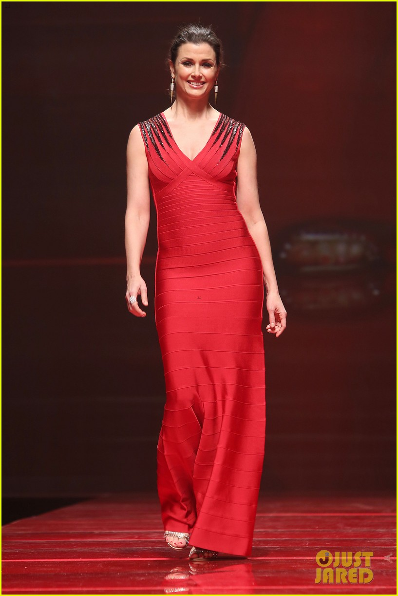 katie holmes models marchesa in red dress show for nyfw 093856472