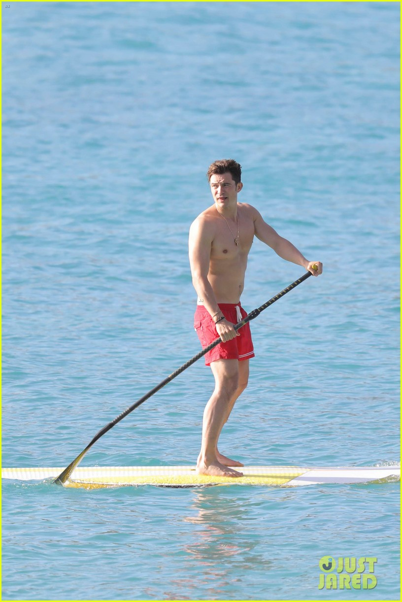 orlando bloom goes paddle boarding but keeps his shorts on 033876672