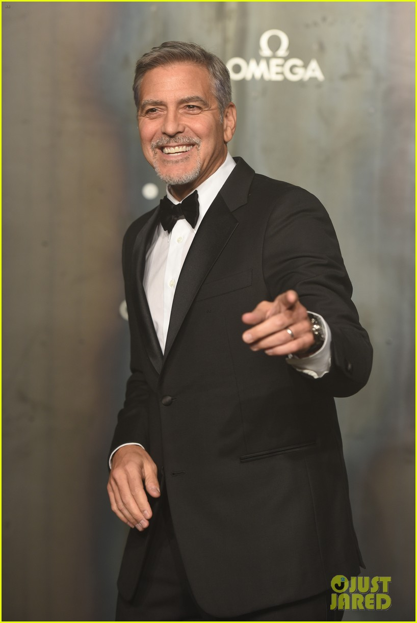 george clooney suits up for lost in space party in london 013890905