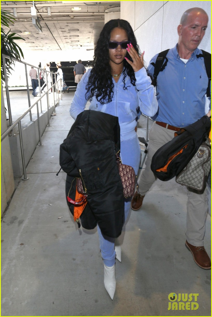 rihanna is pretty in purple velour tracksuit at lax airport 043919301